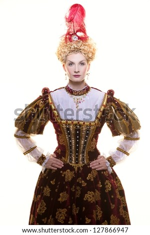 Haughty queen in royal dress isolated on white - stock photo