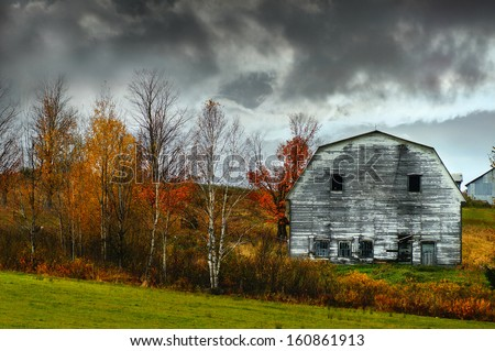 Haunted and creepy old barn, Autumn background                                 - stock photo