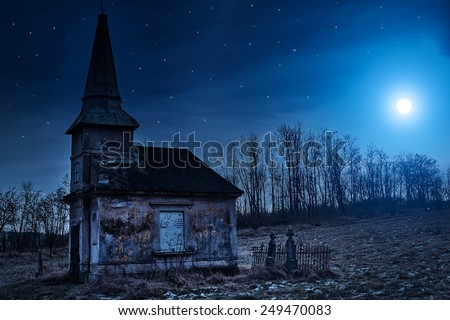 Haunted creepy abandoned graveyard - stock photo