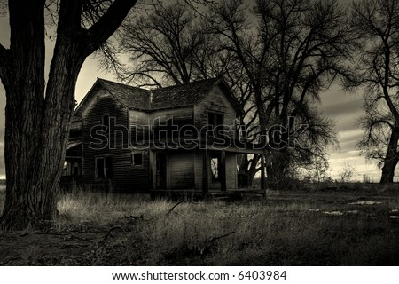 haunted house, as I was told by the locals. Shot in rural Wyoming. A dark, monochrome HDR image with intentionally added grain to enhance mood. - stock photo