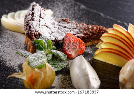 Haute cuisine, dessert on restaurant table, shallow focus depth  - stock photo