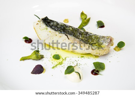 Haute cuisine fish dish - stock photo