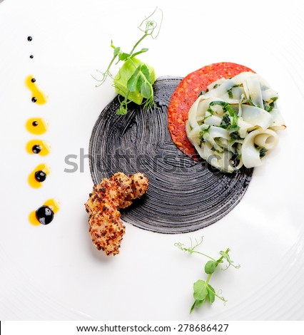 Haute cuisine, Gourmet appetizer, squid, shrimp tempura and Chorizo - stock photo