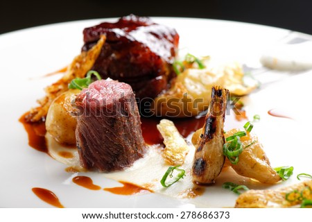 Haute cuisine, grilled Lamb steaks with a sauce of port, and potatoes - stock photo
