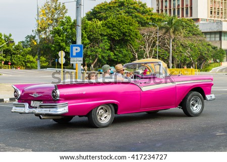HAVANA - APRIL 27: People, cars and buildings in Old Havana (Havana Vieja), Havana, Cuba on April 28, 2016 - stock photo