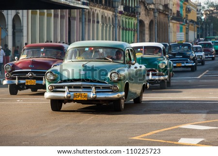 HAVANA-AUGUST 14:Several old classic cars August 14,2012 in Havana.These old cars,the only ones that could be bought until a recent law last year,are an iconic sight on the streets of the city - stock photo