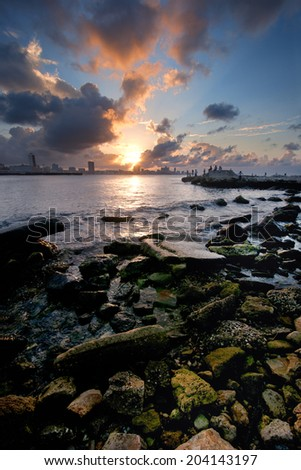 Havana bay entrance and city skyline at sunset with big clouds - stock photo
