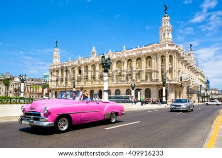 HAVANA,CUBA- APRIL 20,2016 :  Classic vintage car next to the beautiful Great Theater of Havana on a clear sunny day - stock photo