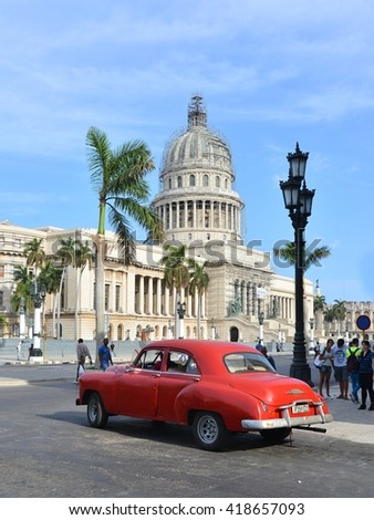 Havana, CUBA - APRIL 7, 2016: Havana,- old American car on street of Havana,CUBA, capitol. Cuba.Havanna, Havana, Havanna. Havana -capitol.Cuba, cars in Havana. Cuba, Havana historic.  Editorial photo. - stock photo