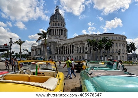 Havana, CUBA - APRIL 5, 2016: Havana old classic American car on street of Havana,CUBA. Cuba - Havana capitol. Cuba cars in Havana. Cuba, Havana historic. Editorial photo. - stock photo