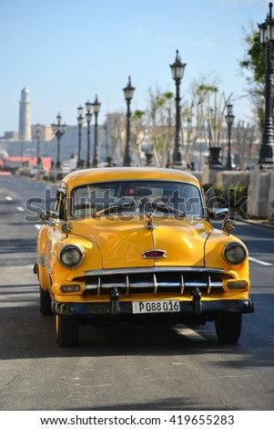 Havana, CUBA - APRIL 7, 2016: Havana, old classic American car on street of Havana,CUBA. Havana, Havanna. Cuba cars in Havana. Havana. Cuba, Havana historic.  Havana. Editorial photo. - stock photo