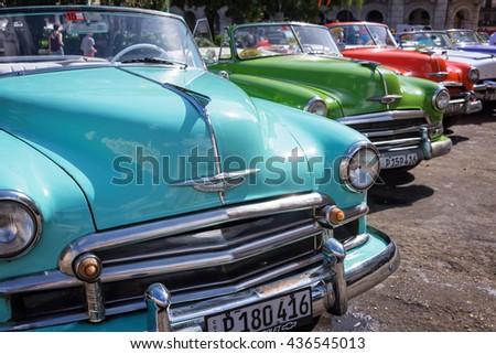 HAVANA, CUBA - APRIL 18: Vintage american cars parked in the main street of Old Havana, on April 18, 2016 in Havana - stock photo