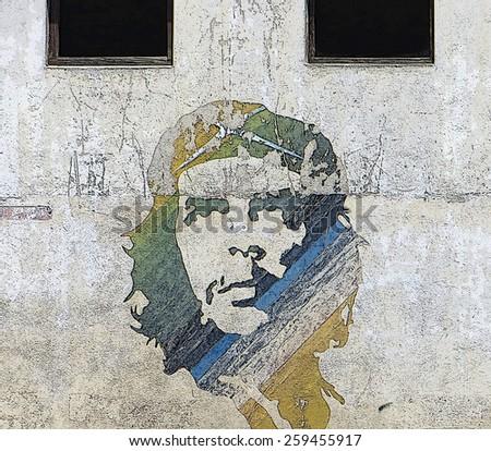 HAVANA, CUBA - APRIL 7, 2014: Wall art image of revolutionary hero Che Guevara in Old Havana.  - stock photo