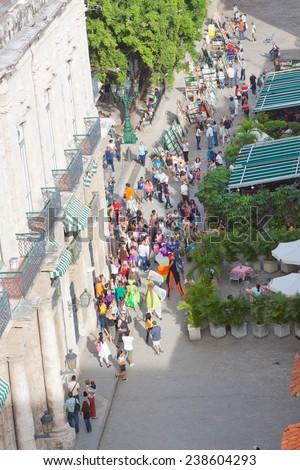 HAVANA, CUBA - DEC 2011: A lot of tourists look performance of street actors - stock photo