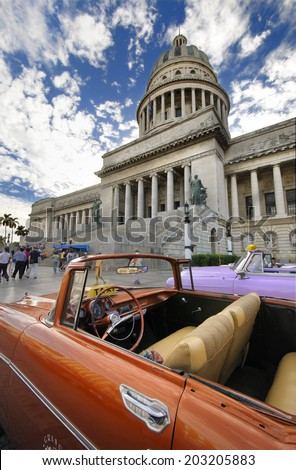 HAVANA, CUBA - DEC 30, 2009. Detail of vintage american car parked in front of the National Capitol Building, the seat of cuban government until 1959. - stock photo