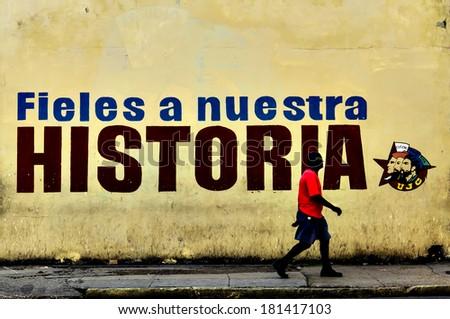 HAVANA, CUBA - DECEMBER 2, 2013: Graffiti and wall paintings presenting remnants of the Cuban Communist  Revolution   - stock photo
