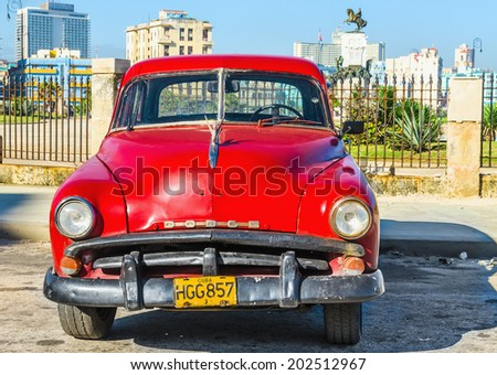 HAVANA, CUBA - DECEMBER 2, 2013: Old classic American red car parked in the old town of Havana, near Malecon (Avenida de Maceo) - stock photo