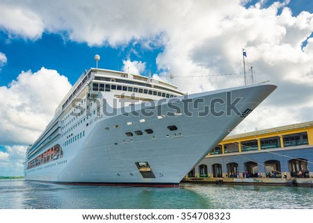 HAVANA,CUBA - DECEMBER 22,2015 : The MSC Opera cruise ship docked at the port of Havana showing the tourist boom the island has experienced in 2015 - stock photo