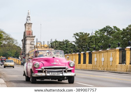 HAVANA,CUBA-FEBRUARY 8,2016:Old obsolete vehicles in Colon Cementery landmark. Both, Cars and the tombs field are major tourist attractions in the Cuban capital. - stock photo