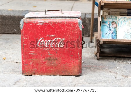 HAVANA,CUBA-FEBRUARY 19,2016:Vintage Coca Cola cooler being sold at antiquities stand. Old Havana is Unesco World Heritage Site and major tourist landmark in the Caribbean Island - stock photo
