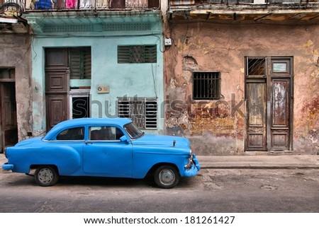 HAVANA, CUBA - FEBRUARY 27, 2011: Vintage oldtimer car parked in the street of Havana, Cuba. Cuba has one of the lowest car-per-capita rates (38 per 1000 people in 2008). - stock photo