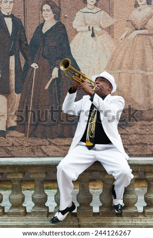 HAVANA, CUBA - JANUARY 8, 2015 : Black cuban musician playing the trumpet - stock photo