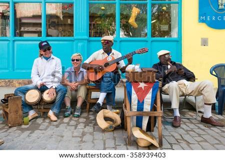 HAVANA,CUBA - JANUARY 5, 2015 : Senior cuban men playing traditional music in the streets of Old Havana - stock photo