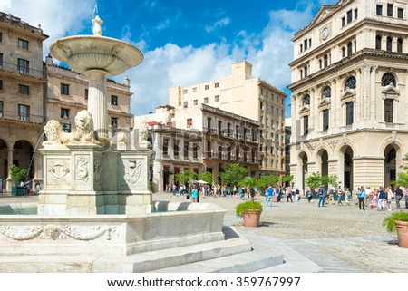 HAVANA,CUBA - JANUARY 5,2016 : Tourists at San Francisco Square in Old Havana - stock photo