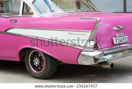 HAVANA,CUBA-JULY 17,2014: Old American Cars in Cuba. Scarcity in cars supply has made Cubans keep 1950's cars and older running through invention and innovation. Nowadays, they make income with them. - stock photo