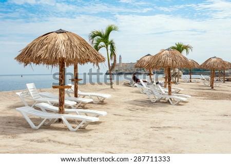 HAVANA,CUBA - JUNE 15:2015 : Art installation resembling a tropical beach at the Havana Biennale - stock photo