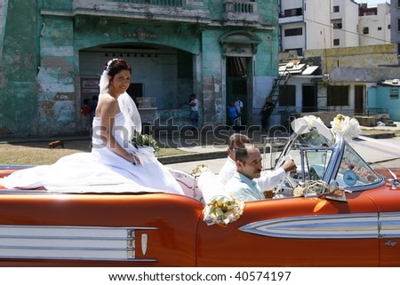 HAVANA, CUBA - MARCH 16: A girl being driven around town during her Quinceanera party on March 16th 2009 in Havana, Cuba. Quinceanera is a traditional Cuban coming-of-age party for 15 year old girls - stock photo