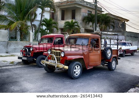 HAVANA, CUBA - MARCH 21, 2015 - Classic old trucks and car on city street. - stock photo