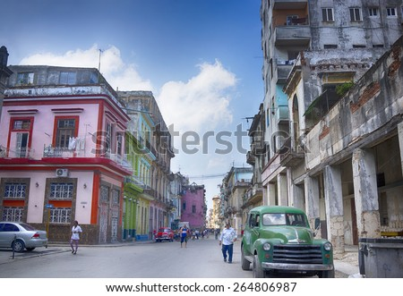HAVANA, CUBA - MARCH 22, 2015 - Colorful street in Old Havana (Viejo Havana) neighborhood, with vintage Chevrolet car. - stock photo