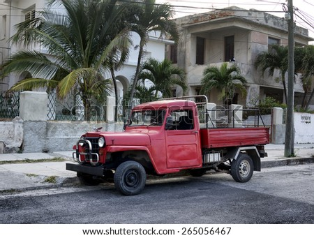HAVANA, CUBA - MARCH 21, 2015 - old, red vintage truck with Packard hood ornament on streets of Havana. - stock photo