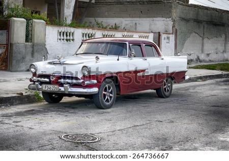 HAVANA, CUBA - MARCH 21, 2015 - vintage Dodge car with Packard hood ornament on city street - stock photo