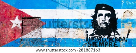 HAVANA,CUBA - MAY 25,2015 : Cuban flag and Che Guevara painted on a grunge old wall in Havana - stock photo