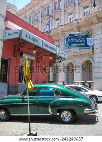 HAVANA, CUBA - May 12, 2009: Old classic American car parked in front of the famous hangout out of Ernest Hemingway, the Floridita Restaurant & bar. Havana,Cuba, May 12, 2009. - stock photo