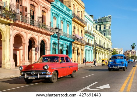 HAVANA,CUBA - MAY 26,2016 : Street scene with old cars and colorful buildings in Old Havana - stock photo