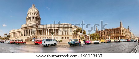 HAVANA, CUBA-MAY 14:Vintage cars near the Capitol on May 14,2013 in Havana.These old cars,the only ones that could be bought until last year,are a famous sight on the streets of the city  - stock photo