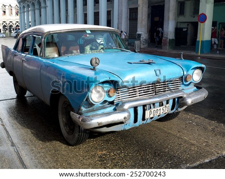 HAVANA, CUBA - NOVEMBER 23:  An american vintage blue car in the center of the town ,on november 23, 2014, in Havana, Cuba  - stock photo
