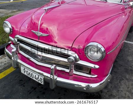 HAVANA, CUBA - NOVEMBER 21: beautiful bright and pink body of a vintage taxi, on november 21, 2014, in Havana, Cuba. - stock photo