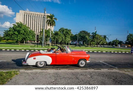 HAVANA, CUBA-OCT 25- Tourists from all over the world enjoy a ride in antique cars used as taxis in Havana, on October 25, 2015  - stock photo
