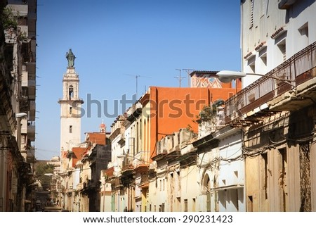 Havana, Cuba - old town street cityscape. Poor neighborhood. Filtered colors. - stock photo