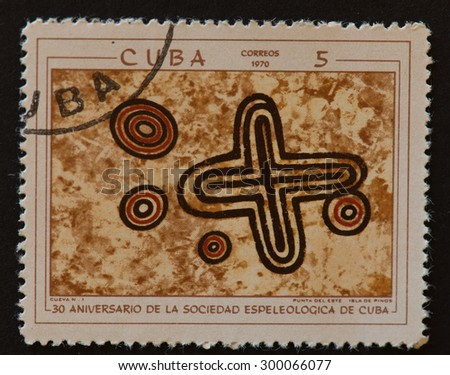 HAVANA,CUBA- REVOLUTIONARY PERIOD: Cuban postal stamp of 1970 showing petroglyphs in Cuban Cave number 1 and commemorating the 30th Anniversary of the Speleological Society of Cuba.  - stock photo