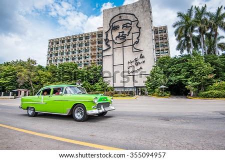 Havana, Cuba - September 22, 2015: Tourist drive vintage car in Plaza de la Revolution, Havana, Cuba. - stock photo