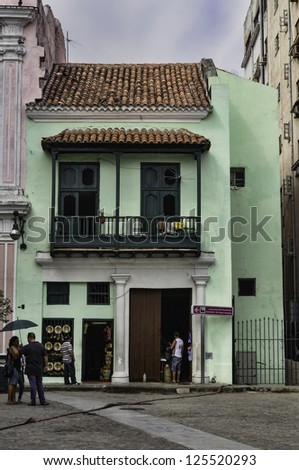 Havana, Cuba. Street scene with old car and worn out buildings. - stock photo