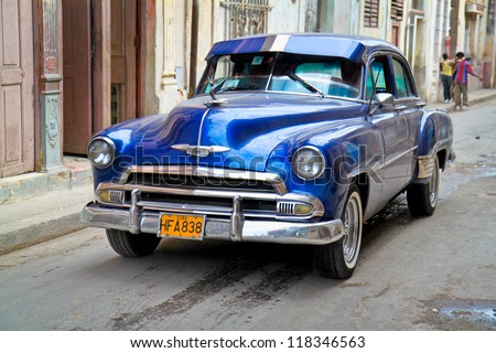 HAVANA-FEB 4:Classic Oldsmobile waiting for tourists on February 4,2010 in Havana.Thousands of these vintage cars are in use in Cuba and have become a touristic attraction. - stock photo