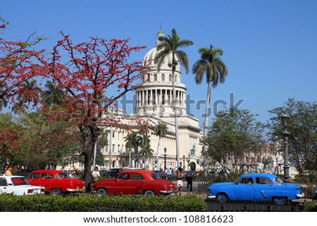 HAVANA - FEBRUARY 25: Classic American cars on February 25, 2011 in Havana. Recent change in law allows the Cubans to trade cars again. Most cars in Cuba are very old because of the old law. - stock photo