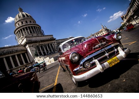 HAVANA - FEBRUARY 12: Classic car parked on the street on February 12, 2013 in Havana. These old and classic cars are an iconic sight of the Cuba Island. - stock photo