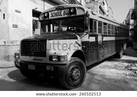 HAVANA - FEBRUARY 17: Classic school bus on streets of Havana on February 17, 2015 in Havana. These vintage cars are an iconic sight of the island - stock photo